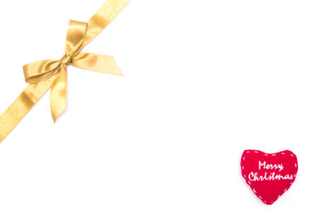 Christmas gold ribbon and heart on white background photo
