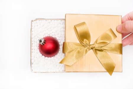 Gift box with a christmas ball inside photo