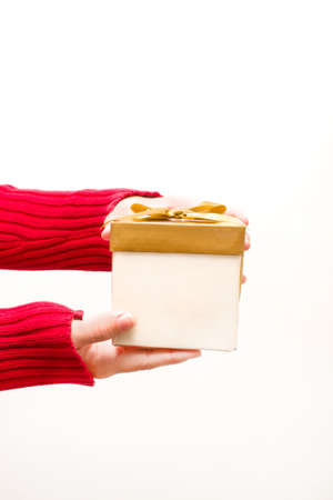 Woman with a gift box in hands photo