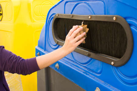 segregate: Throwing a paper recycling container