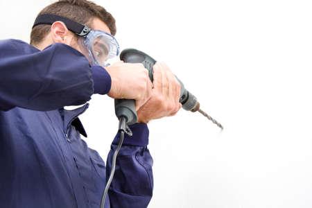 making hole: Man drilling