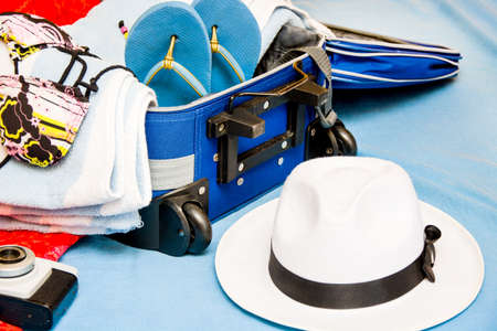 bathing   suit: Packing a suitcase for summer Stock Photo