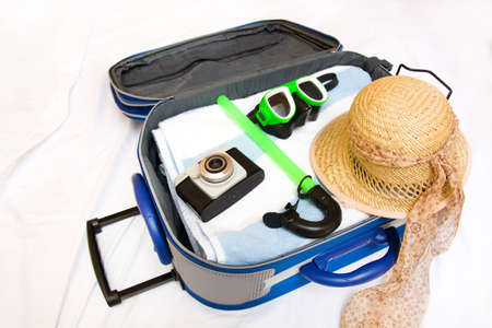 Packing a suitcase for summer Stock Photo