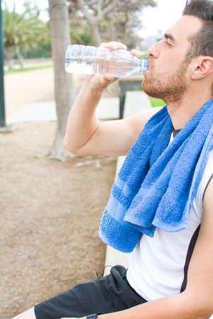 man drinking water: man drinking water after exercise practice