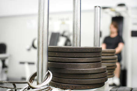 muscle gain: woman in gym Stock Photo