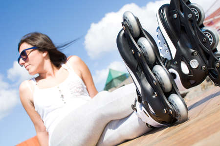 rollerskates: woman with roller-skates Stock Photo
