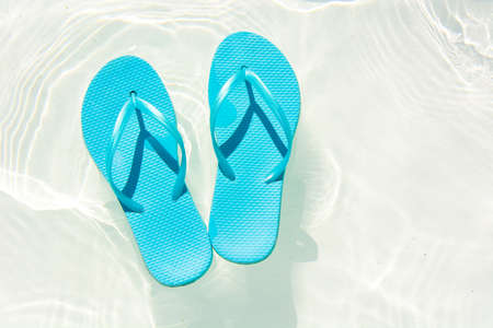 swimming shoes: summer shoes afloat in the swimming pool Stock Photo
