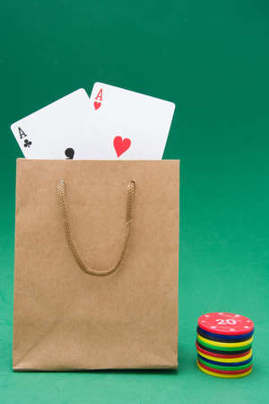 poker player: cardboard bag with poker cards and poker chips