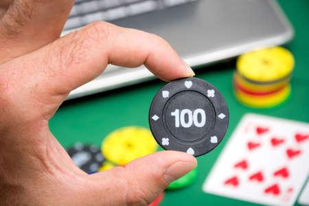 poker chip: Man showing a poker chip