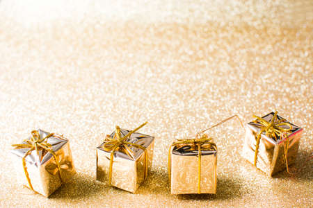 cold background: Golden gift boxes with golden glitter background