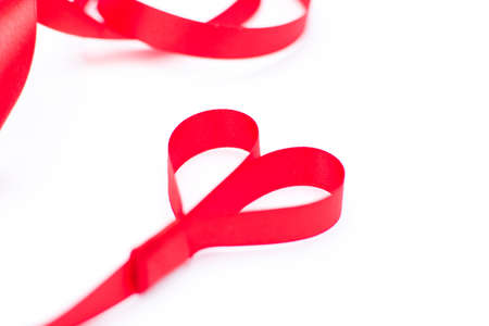 day valentine: Red ribbon with heart shape