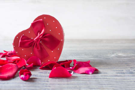 valentine's day: Gift box with heart shape and petals