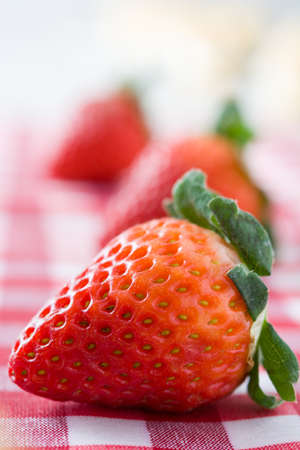 checkered tablecloth: Strawberry on checkered tablecloth Stock Photo