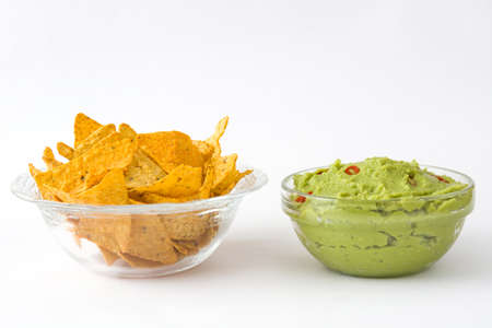 nachos: Nachos and guacamole on white background Stock Photo