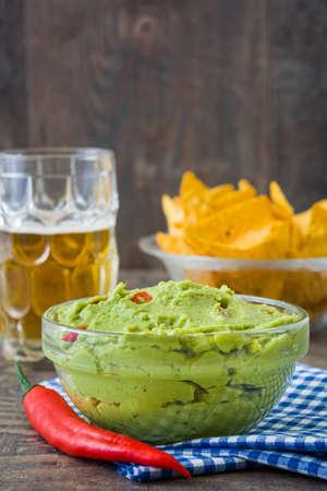 guacamole: Nachos, guacamole and beer
