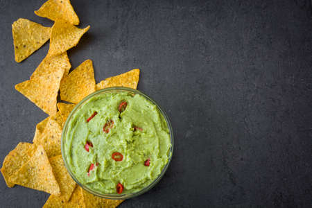 nachos: With Guacamole nachos. Black background