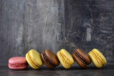 colorful macarons on wood Banco de Imagens