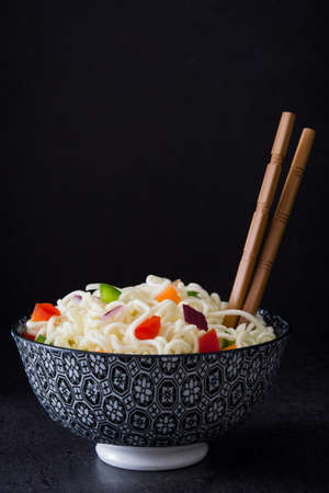 asian noodles: Asian noodles and vegetables on slate Stock Photo