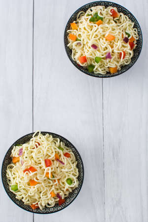 asian noodles: Asian noodles and vegetables on a white wood
