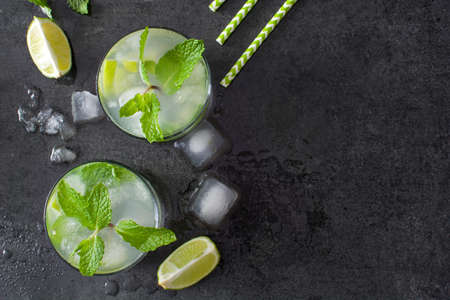 mint leaves: Fresh mojito cocktail on slate Stock Photo