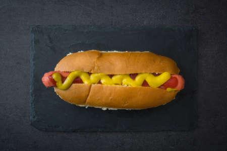 unhealth: Hot dog on slate table