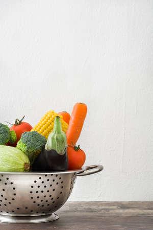 colander: Vegetables in a colander Stock Photo
