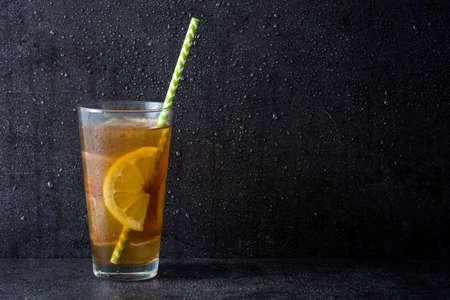 Ice tea with lemon. Black stone Stock Photo