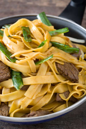 chow: Beef chow mein in a frying pan. Chinese food Stock Photo