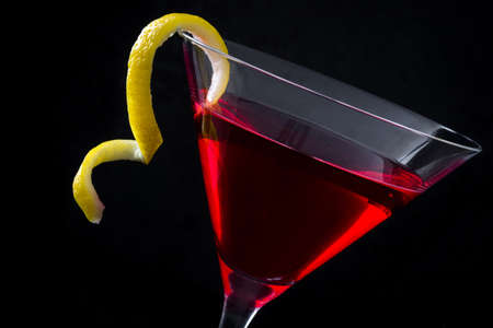 cosmopolitan: Cosmopolitan cocktail on black background Stock Photo