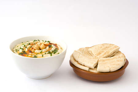 Hummus and pita bread in bowl isolated on white background Stock Photo