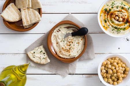 Hummus and pita bread on white wood Stock fotó - 56967580