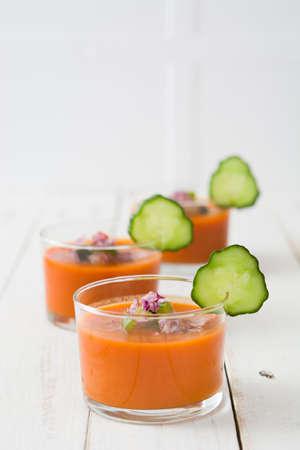 gazpacho: Gazpacho soup in glass on white wood