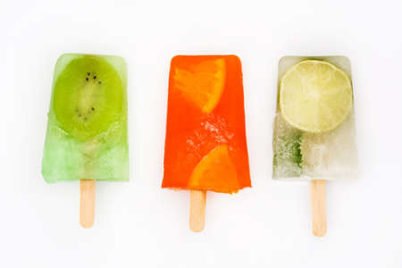 Homemade fruit popsicles isolated on white background