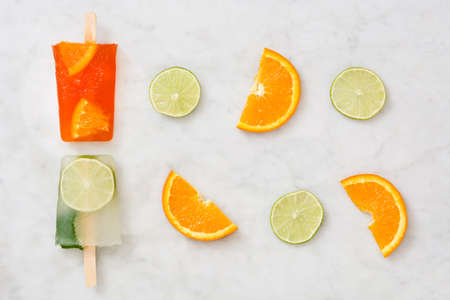 popsicle: Orange and lime popsicle popsicle on marble Stock Photo