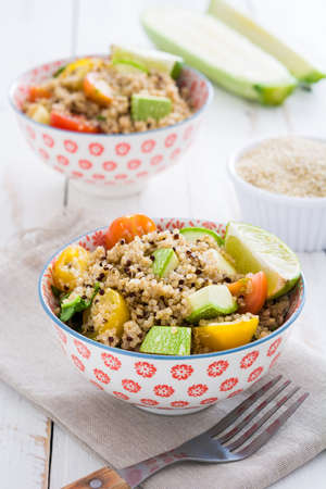 protein crops: Quinoa salad on a white wooden table Stock Photo