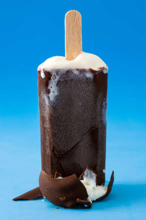 popsicle: chocolate popsicle on blue background