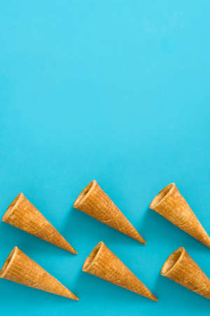 cornet: cone, cream, ice, summer, blue, object, cornet, wafer, background, dessert, crisps, snack, serving, tasty, close up, texture, color, waffle, baked, sweet, empty