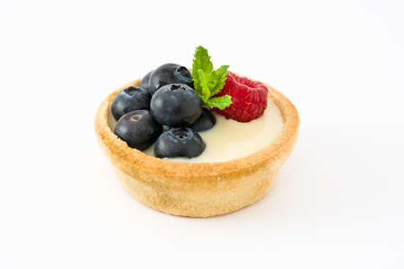 tartlet: Delicious tartlet with raspberries and blueberries isolated on white background