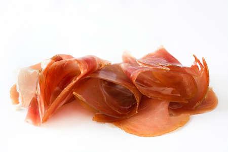 serrano: Thin slices of spanish serrano ham isolated on white background