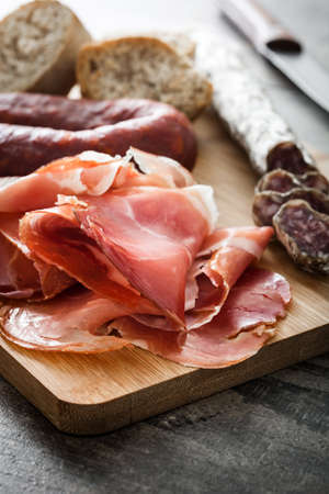 serrano: Spanish serrano ham and sausages on a rustic wooden table