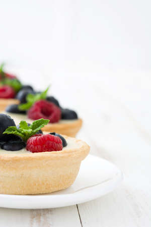 summer pudding: Delicious tartlets with raspberries and blueberries Stock Photo