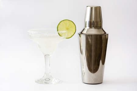 cocktail shakers: Margarita cocktail into a glass and shakers isolated on white background Stock Photo