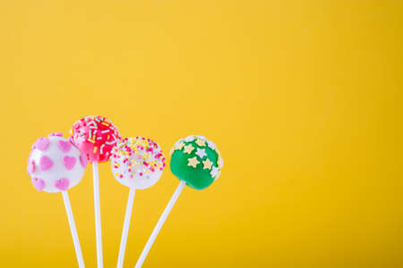 cake pops: Cake pops on yellow background
