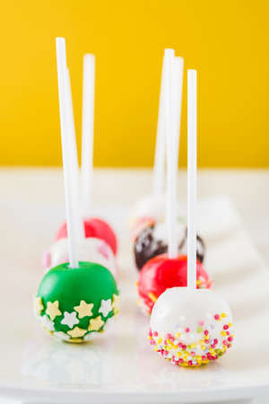 pops: Cake pops on yellow background