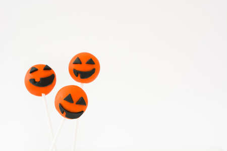 pops: Halloween cake pops with pumpkin shape isolated on white background