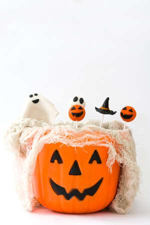 Halloween cake pops in a basket with pumpkin shape