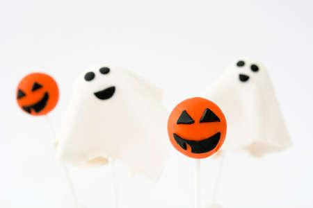 phantom: With Halloween cake pops phantom and pumpkin shape isolated on white background Stock Photo