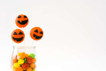 cake pops: Halloween cake pops and colored candies isolated on white background Stock Photo