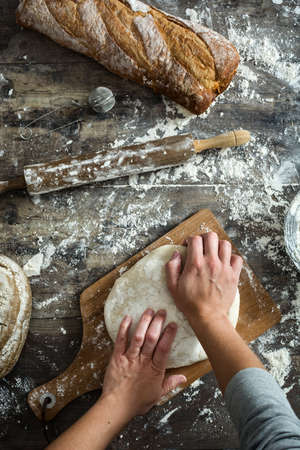 woman kneading bread dough With her hands