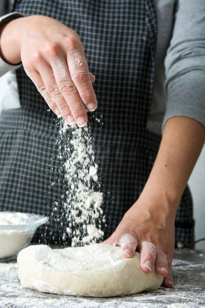 kneading: woman kneading bread dough With her hands
